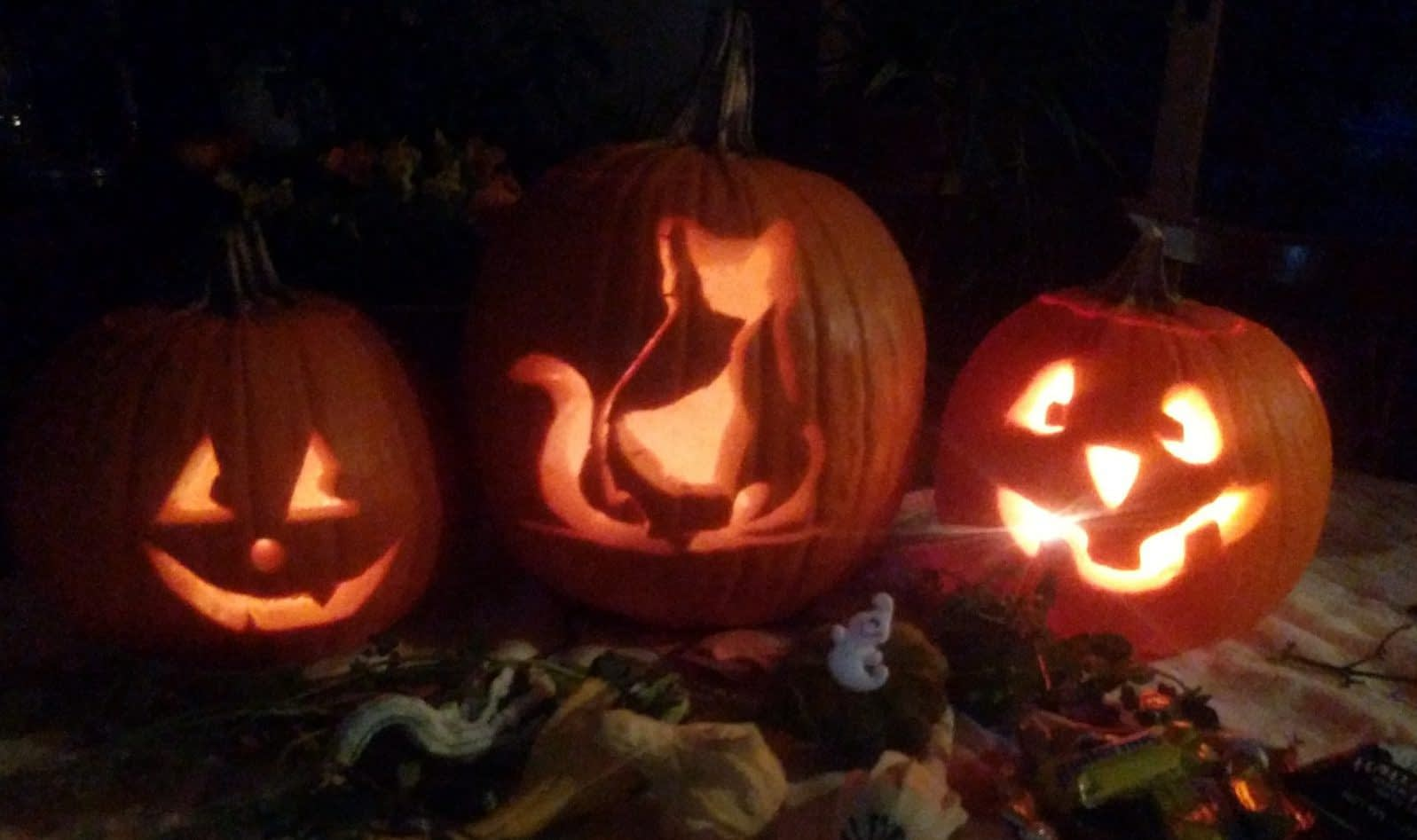 3 lit pumpkins
